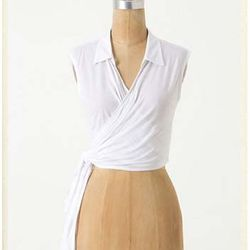 """<a href=""""http://www.anthropologie.com/anthro/product/shopsale-tops/24656464.jsp"""">Spritzer Tie Top</a> $19.95, was $58"""