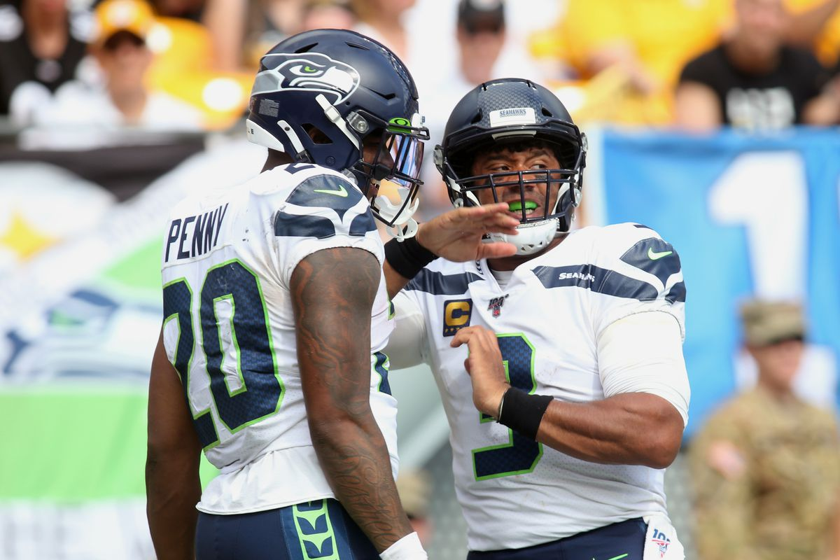 Seattle Seahawks running back Rashaad Penny celebrates with quarterback Russell Wilson after scoring on a thirty seven yard touchdown run against the Pittsburgh Steelers during the third quarter at Heinz Field.