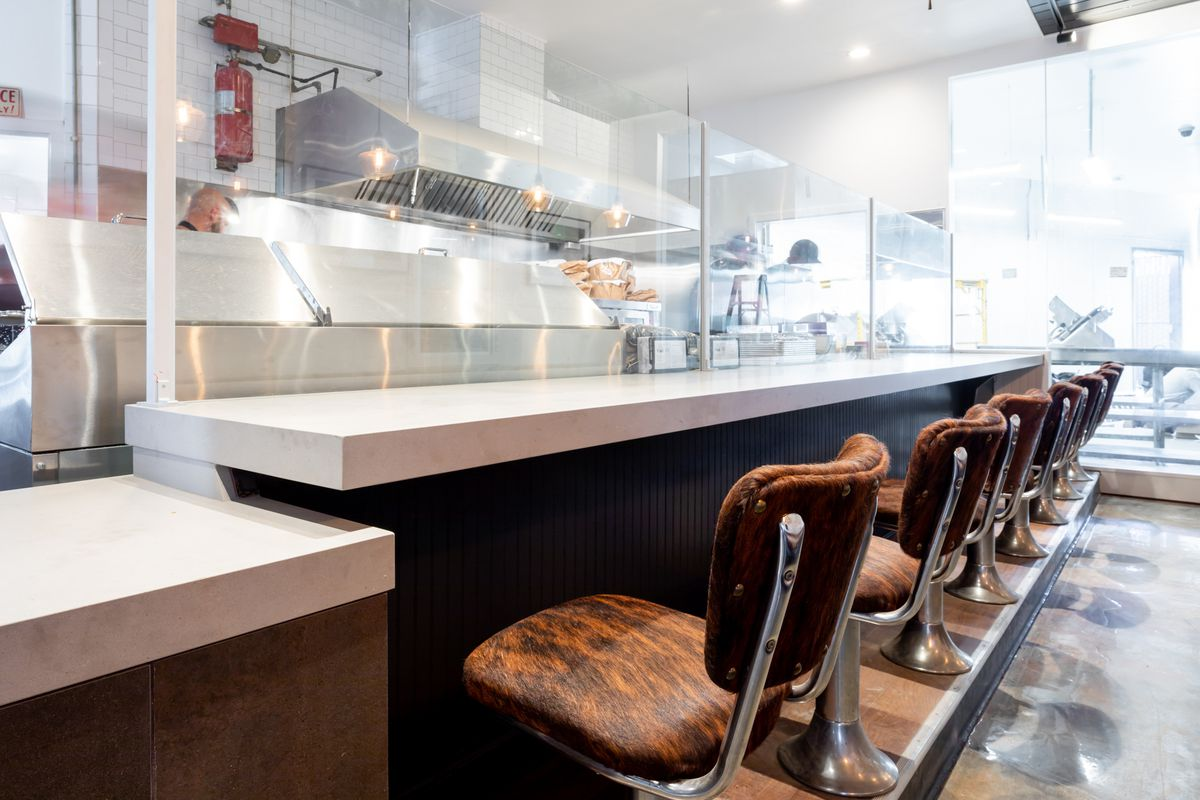 Cowhide stools at the diner counter