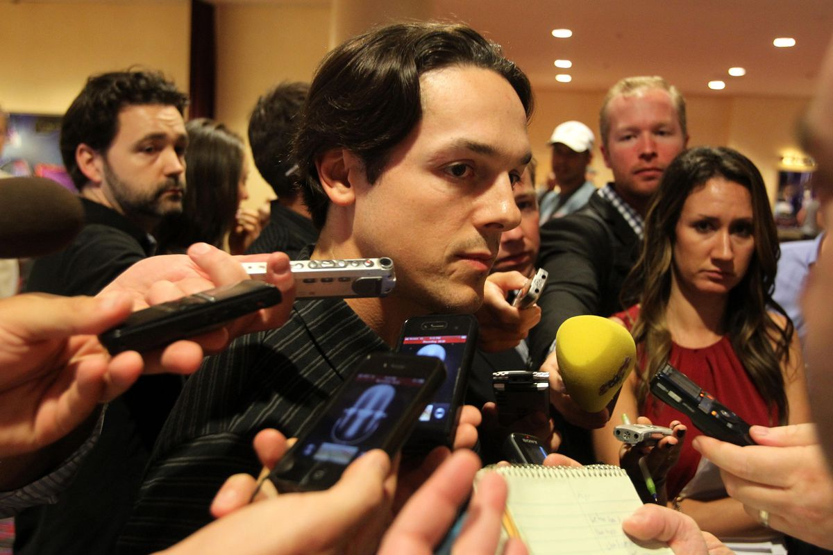 September 12, 2012; New York, NY, USA; NHL player Daniel Briere (center) speaks with reporters during the 2012 NHLPA summer player meetings at the Marriott Marquis. Mandatory Credit: Brad Penner-US PRESSWIRE