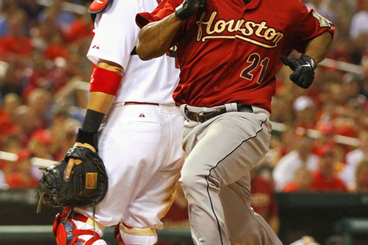 ST. LOUIS, MO - JULY 27: Michael Bourn #21 of the Houston Astros scores a run against the St. Louis Cardinals at Busch Stadium on July 27, 2011 in St. Louis, Missouri.  The Astros beat the Cardinals 4-2.  (Photo by Dilip Vishwanat/Getty Images)