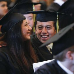 Friends Madeleine Chuy, left, and Edwin Toledo enjoy their graduation as they join classmates at LDS Business College's 125th Commencement in the Tabernacle on Temple Square in downtown Salt Lake City Friday, April 13, 2012.