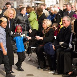 Salt Lake City Mayor Jackie Biskupski walks back to her seat with her fiancÉe's son, Jack, and her own son, Archie, following her remarks at her swearing-in ceremony outside the City-County Building on Monday, Jan. 4, 2016.