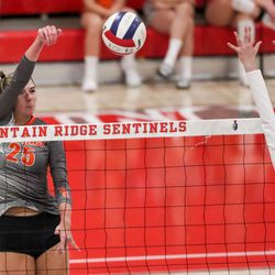 Skyridge's Rose Moore hits the ball toward Mountain Ridge in a girls volleyball match in Herriman on Tuesday, Sept. 7, 2021.