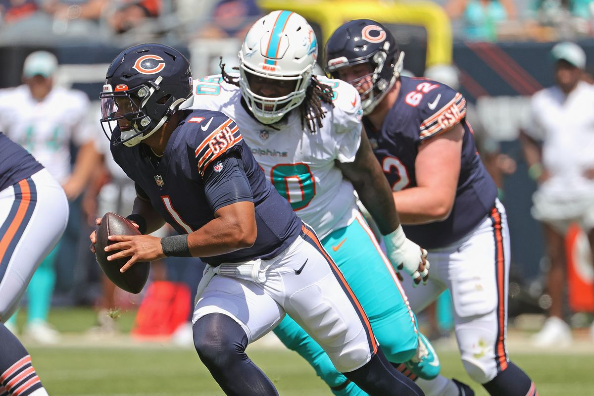Bears quarterback Justin Fields scrambles against the Dolphins in his preseason opener.