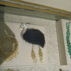 Wilfredo Rosado 18k white gold feather brooch w/ diamonds, emeralds, sapphires, & spinels, $89,000