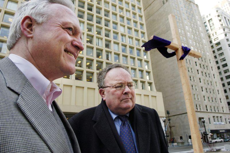 Attorney John Mauck of Mauck & Baker (left).