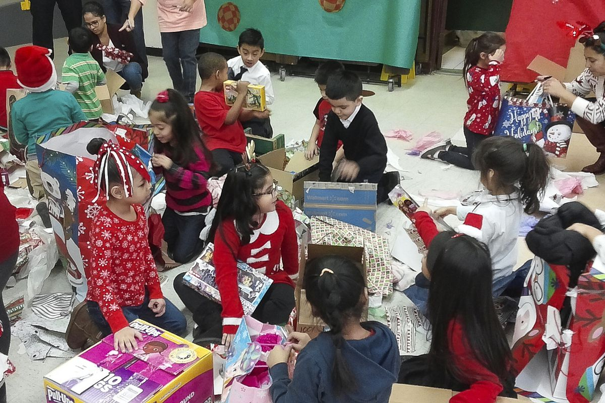 Students at Octavio Paz elementary opening their gifts from a previous year's Chicago Sun-Times' Letters to Santa program.