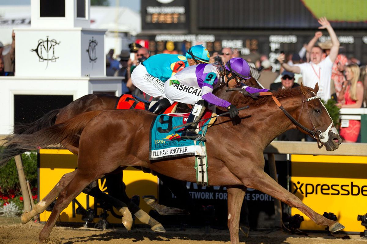 May 19, 2012; Baltimore, MD, USA; Mario Gutierrez aboard I'll Have Another pulls past Mike Smith aboard Bodemeister to win the 137th running of the Preakness Stakes at Pimlico Race Course. Mandatory Credit: Maxwell Kruger-US PRESSWIRE
