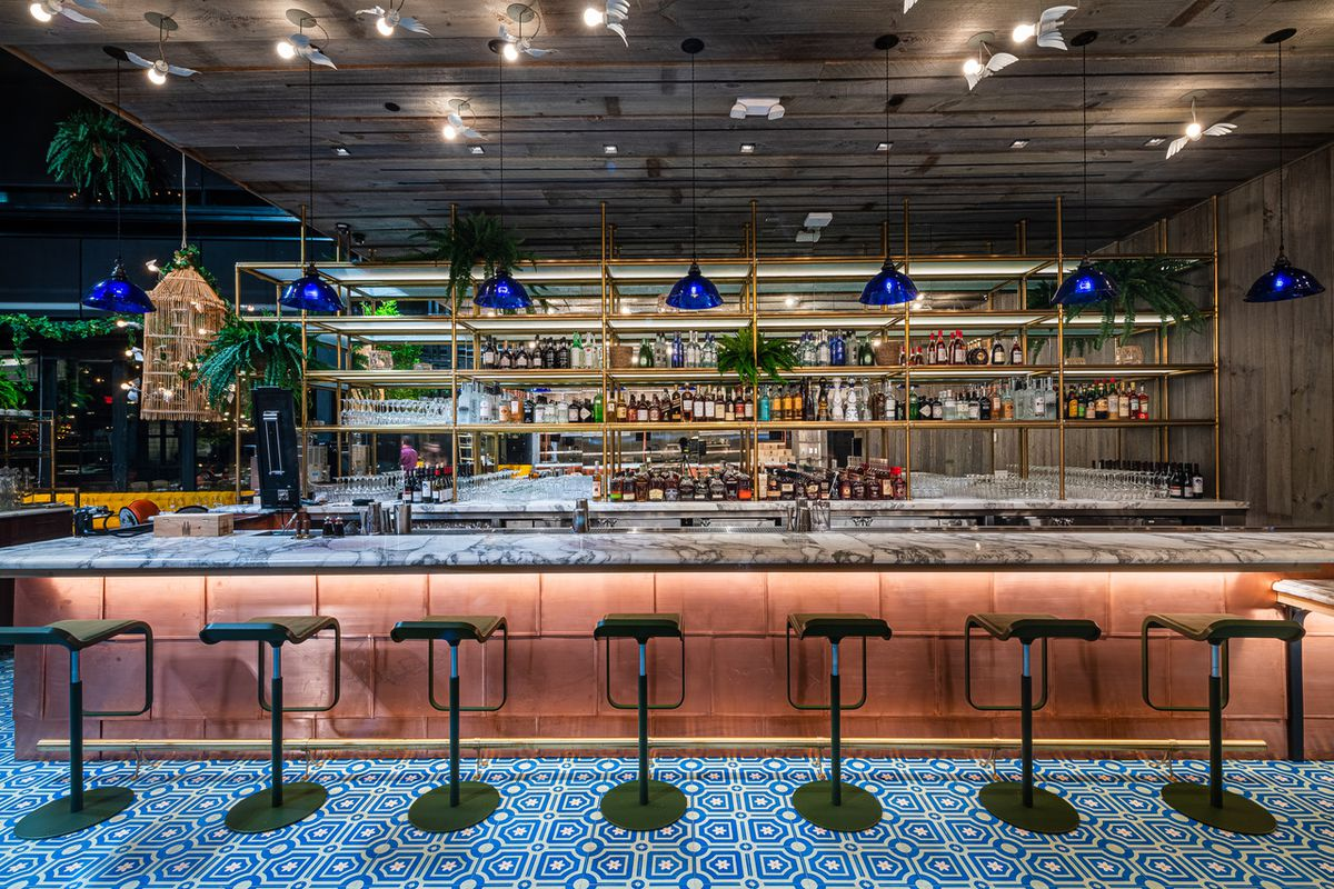 The bar at Ilili features marble and copper detailing.