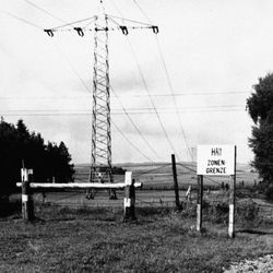"""The post and barbed wire fence separate East and West Germany near Fulda on July 28, 1959. A sign reading """"Halt, Zone Border"""" warns the unwary that this is the end of freedom."""