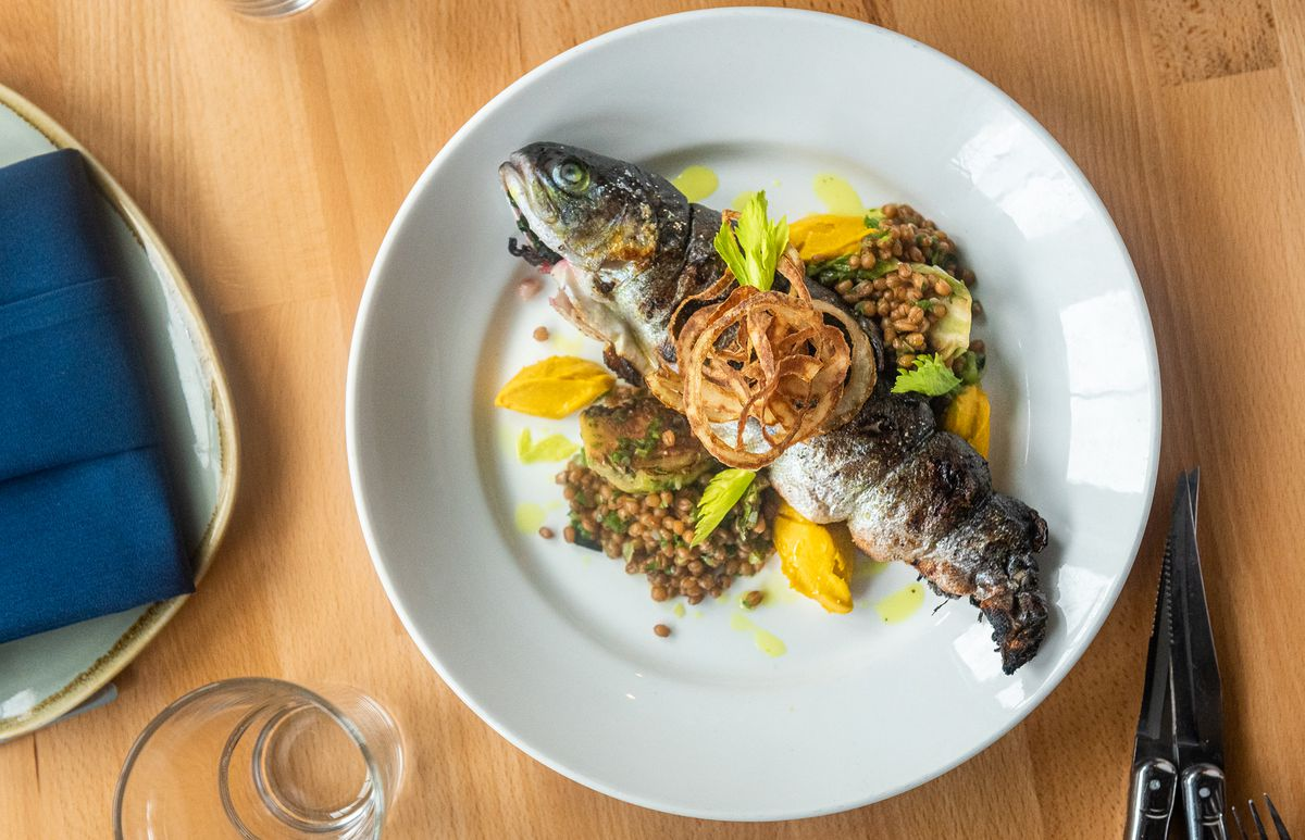 Nina May's stuffed rainbow trout stuffed with swiss chard, Maryland wheat berries, crispy onions, and turmeric ginger coulis