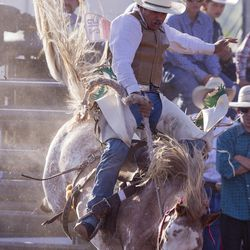 Scott Lauaki rides a saddle bronc during the Utah High School Rodeo Finals in Heber City on Saturday, June 3, 2017.