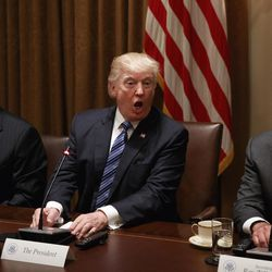 President Donald Trump, flanked by Vice President Mike Pence and Secretary of State Rex Tillerson, speaks during a meeting with South Korean President Moon Jae-in in the Cabinet Room of the White House in Washington, Friday, June 30, 2017.