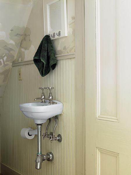 A wall-mounted sink in a powder room.