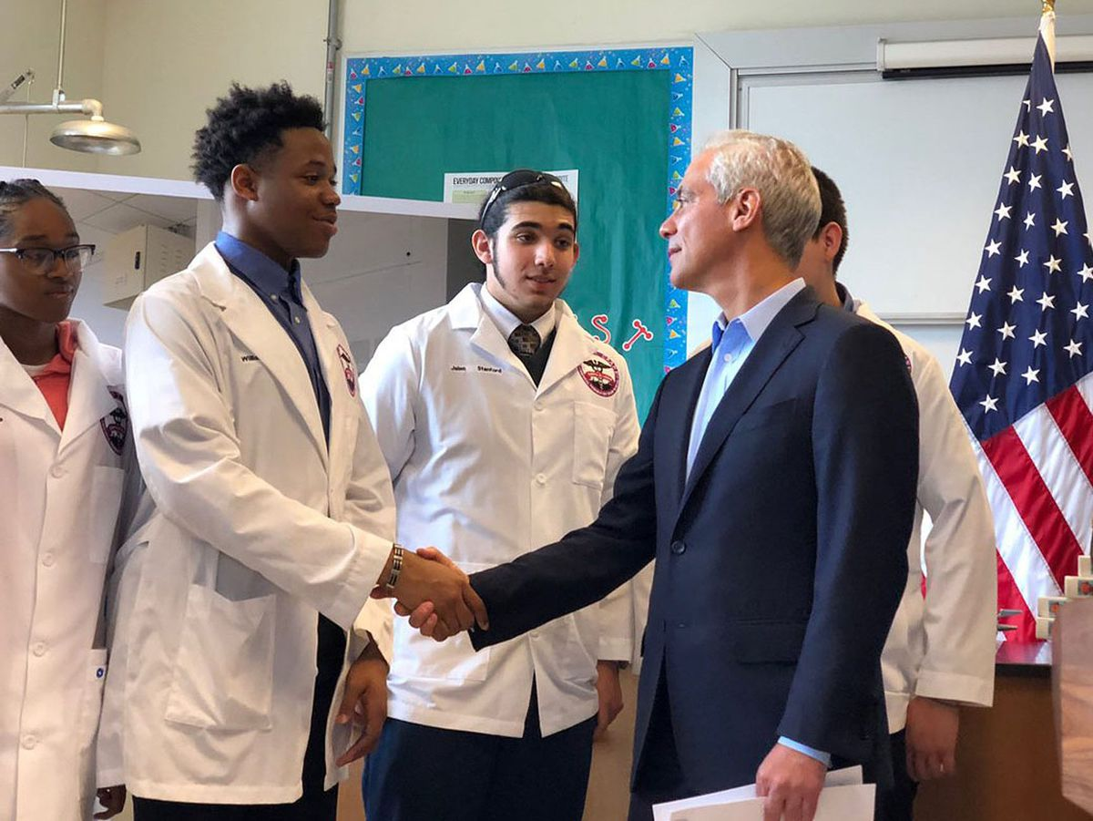 Chicago Mayor Rahm Emanuel greets students at Crane Medical Preparatory High School, where he and Chicago Public Schools CEO Janice Jackson announced a $75 million program to upgrade school science labs. | Fran Spielman/Sun-Times