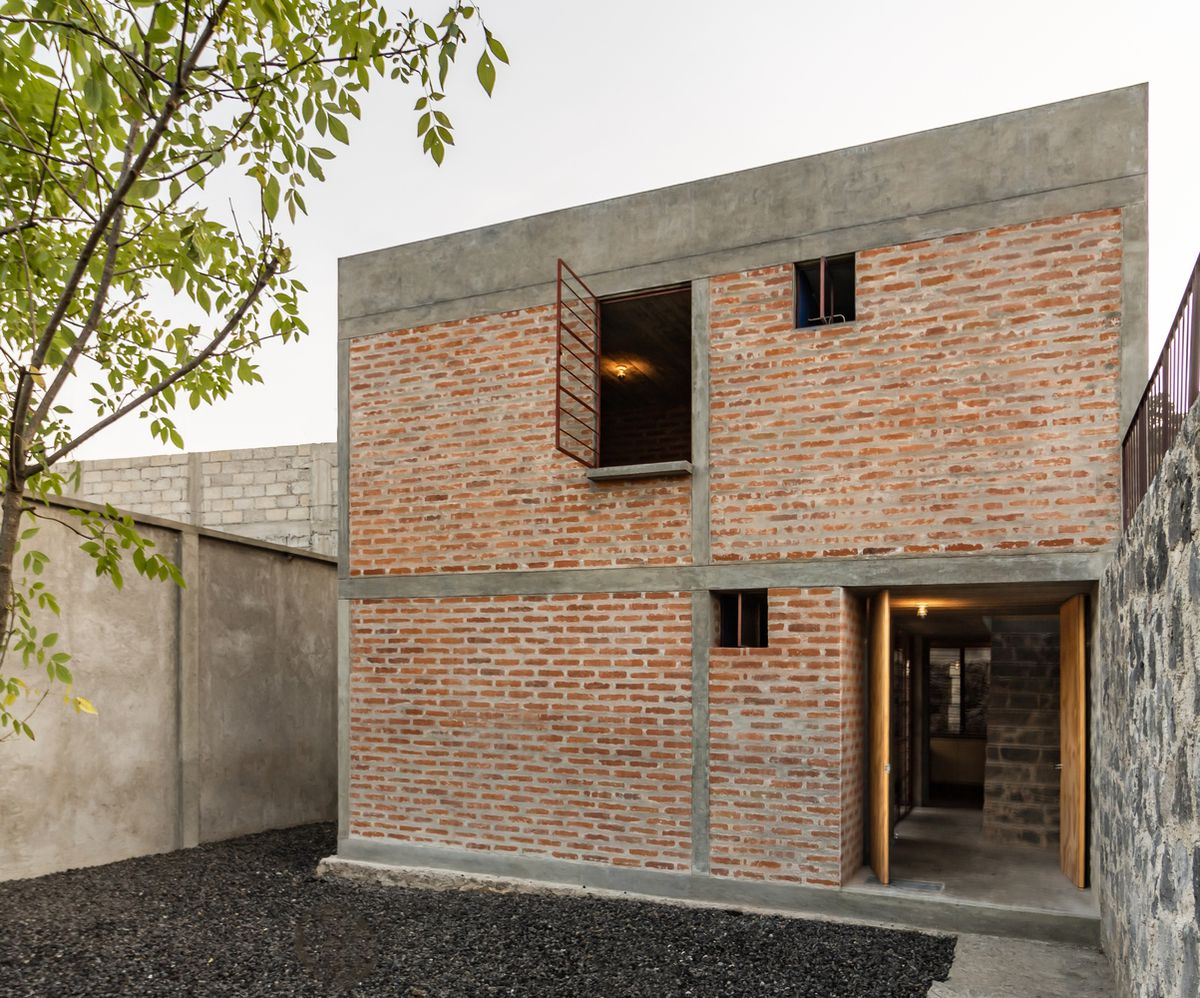 Facade of home built from brick.