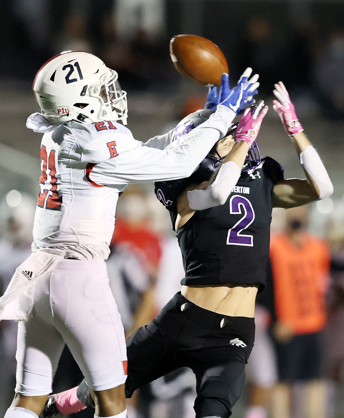 East's Tuione Tausinga and Riverton's Jaxon Bennett go up for the ball as East and Riverton play a high school football game in Riverton on Friday, Oct. 9, 2020. East won 36-20.