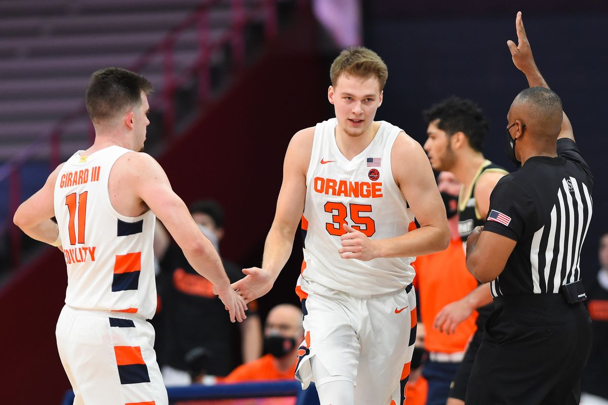 Syracuse Orange guard Joseph Girard III greets guard Buddy Boeheim after a made three-point basket against the Bryant University Bulldogs during the second half at the Carrier Dome.