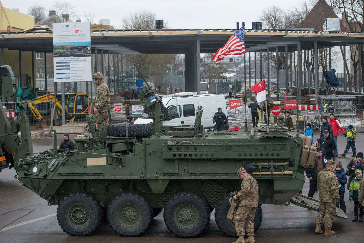 US troops pause in their parade in Narva, Estonia, literally feet from a Russian border crossing
