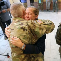 Utah Air National Guard Col. Ken Verboncoeur hugs Utah Air National Guard Brig. Gen. Christine Burckle after her retirement ceremony at the Roland R. Wright Air National Guard Base in Salt Lake City on Thursday, Aug. 29, 2019.