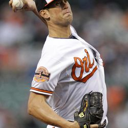 Baltimore Orioles starting pitcher Brian Matusz throws against the New York Yankees in the first inning of a baseball game in Baltimore, Monday, April 9, 2012.