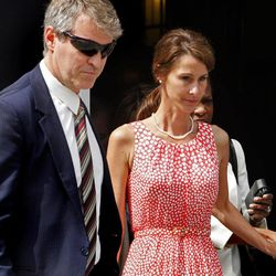 Cheri Young, right,  is escorted out of the Federal Courthouse in Greensboro, N.C. on Monday, April 30, 2012, after testifying in the John Edwards trial. Young, the wife of an ex-aide to John Edwards broke down on the witness stand Monday as she recounted how the candidate asked the couple to hide an affair he was having and justified using wealthy donors' money to do it.