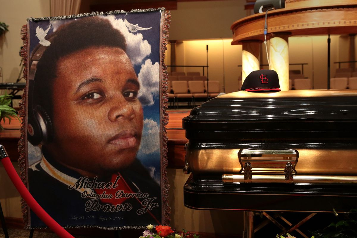 A memorial and casket at Michael Brown's funeral.