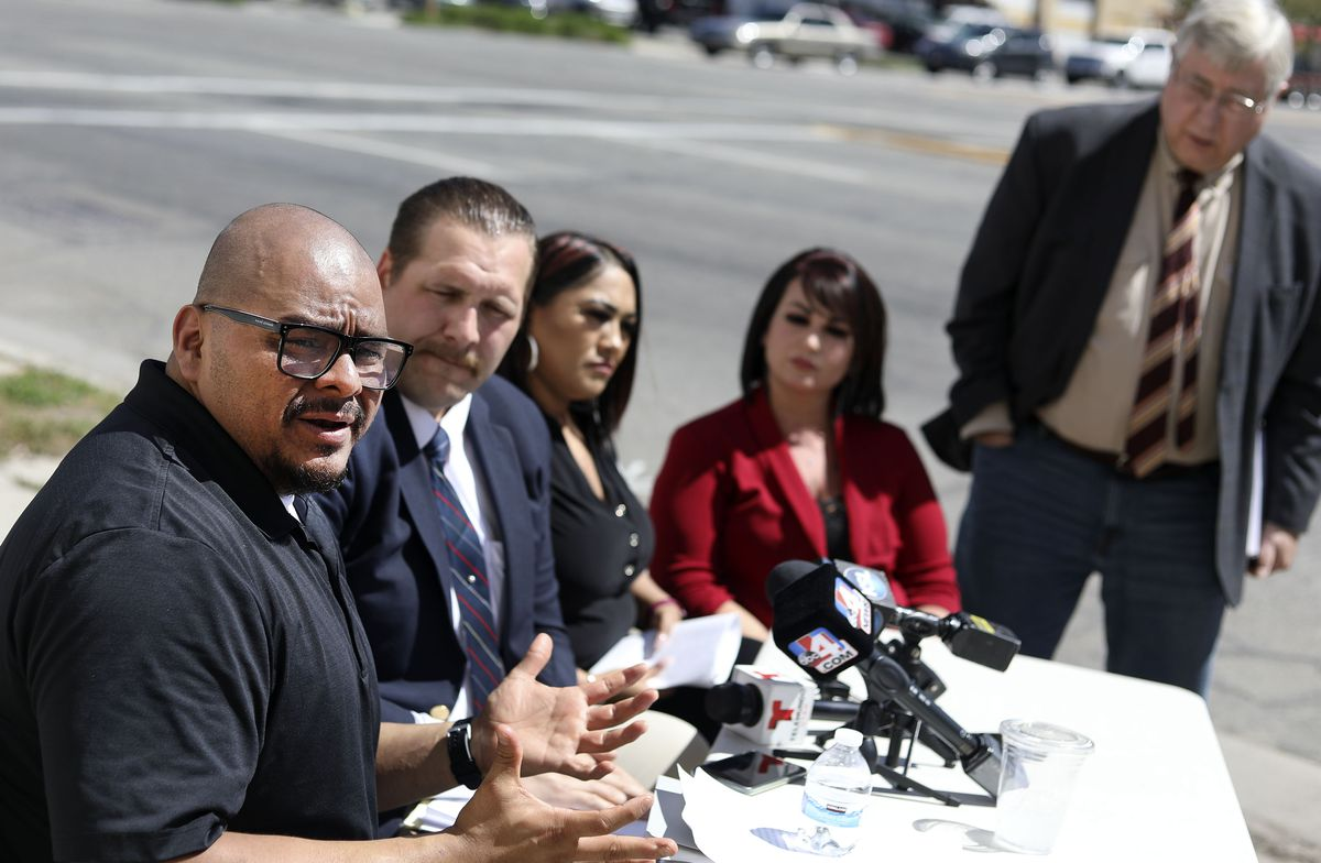 Mario Herrera, left, cousin of Bryan Peña Valencia, left, attorney Pete Sorensen, Anna Herrera and Brittny Herrera, cousins of Peña Valencia, and attorney Robert B. Sykes hold a press conference underneath Peña Valencia's portrait on a building at 900 South and 300 West in Salt Lake City on Wednesday, May 5, 2021. Peña Valencia was shot by a Unified police officer on March 21, 2020, after police responded to a 911 call about gunshots in the area of 6200 S. Bangerter Highway.