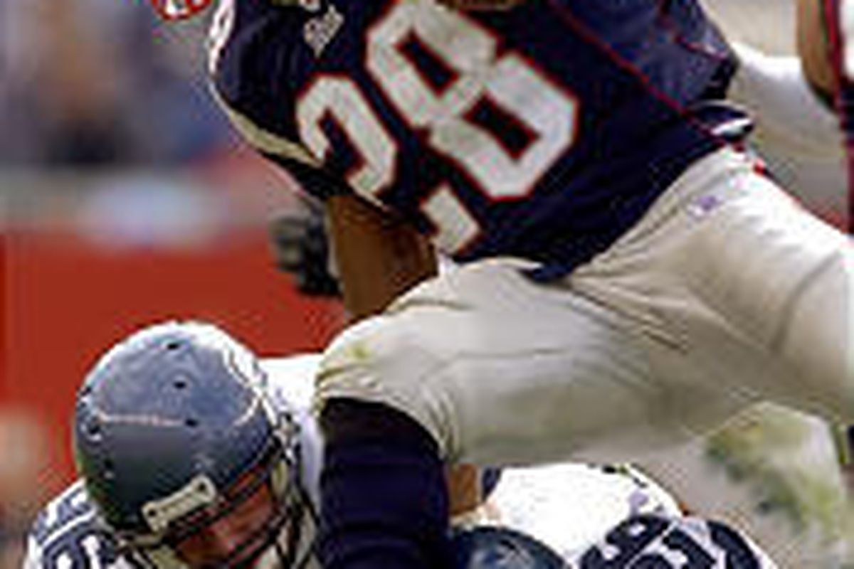 New England Patriots running back Corey Dillon jumps over a couple of Seattle Seahawk defenders in Sunday's game.