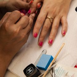 Manicurist Carol J. Castillo applies a first coat.