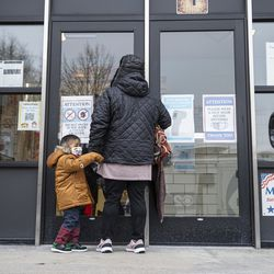 Parent and Teacher at Suder Elementary Angelica Castillo walks with her son to begin their day of classes at Suder elementary at 2022 W Washington Blvd in West Town, Monday, Jan. 11, 2021.