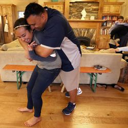 Kalani Sitake hugs his daughter Skye at home in Provo on Friday, March 11, 2016.