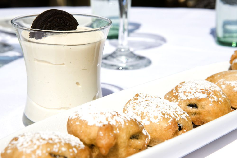 """<span data-author=""""-1"""">A pastry on a long white plate with a milkshae with an Oreo on the side.</span>"""