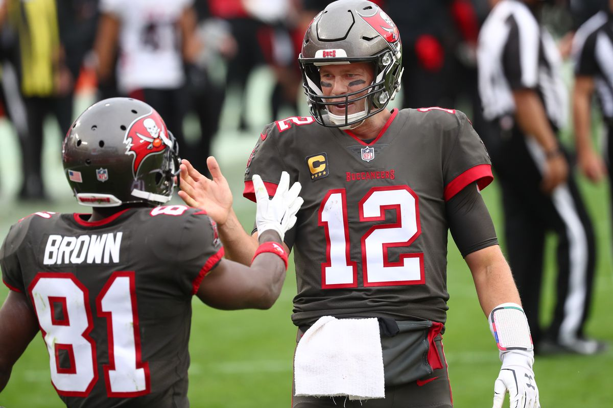 Tampa Bay Buccaneers quarterback Tom Brady (12) smiles with wide receiver Antonio Brown (81) after he scored a touchdown against the Atlanta Falcons during the second half at Raymond James Stadium.