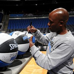 Orlando Magic Head Coach Jacque Vaughn signs more than 300 basketballs during the internal team autograph session on Monday, November 26.  All autographed items will be distributed back into the Central Florida community.