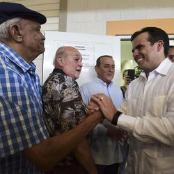 Gov. Ricardo Rossello greets people after voting at the San Jose Academy during the fifth referendum in San Juan, Puerto Rico, Sunday, June 11, 2017. Puerto Ricans are getting the chance to tell U.S. Congress on Sunday which political status they believe best benefits the U.S. territory as it remains mired in a deep economic crisis that has triggered an exodus of islanders to the U.S mainland. Congress ultimately has to approve the outcome of Sunday's referendum that offers voters three choices: statehood, free association/independence or current territorial status.
