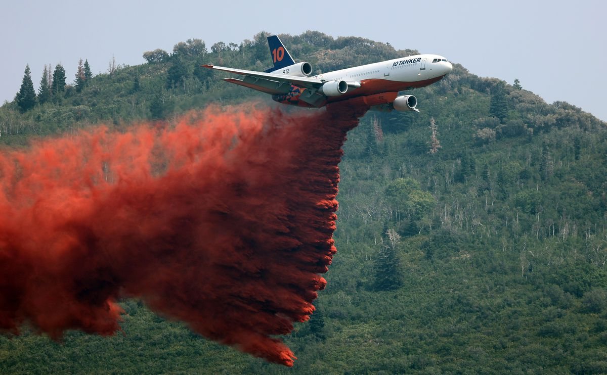 A large tanker drops retardant as crews fight the Parleys Canyon Fire near Park City on Sunday, Aug. 15, 2021.
