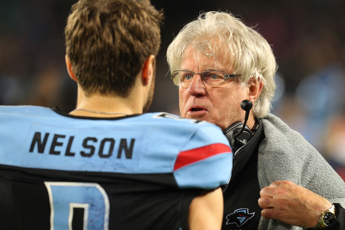 Offensive coordinator Hal Mumme of the Dallas Renegades talks to Philip Nelson on the sidelines at an XFL Game against the St. Louis Battlehawks on February 09, 2020 in Arlington, Texas.