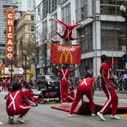 The Jesse White Tumblers perform in the Columbus Day Parade as it travels down North State Street in the Loop, Monday afternoon, Oct. 11, 2021.