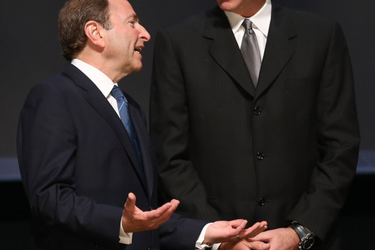 Many NHL fans worry the Penguins enjoy special favors from the NHL. I don't know, Bettman almost does look puppet-sized compared to Lemieux.  (Photo by Bruce Bennett/Getty Images)
