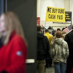While many individuals attended the 2013 Rocky Mountain Gun Show to purchase ammunition, many others sought to sell their own weapons or purchase used ones, Saturday, Jan. 5, 2013.
