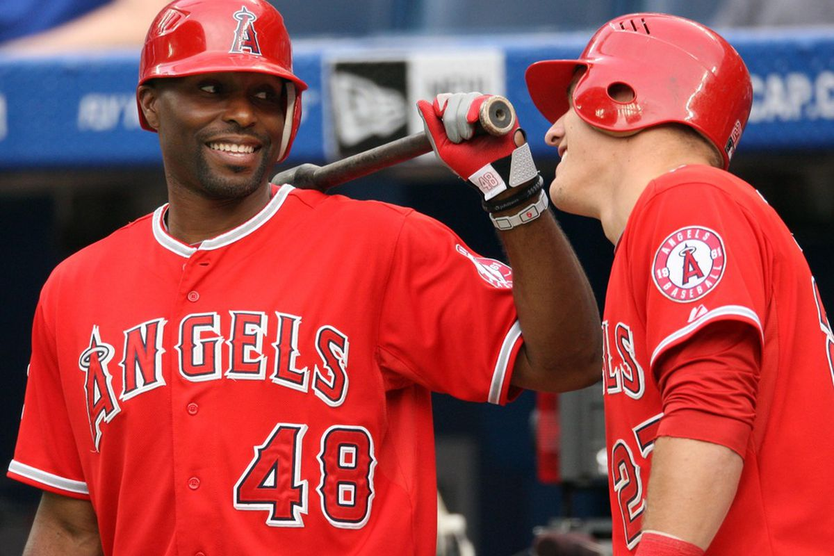 Jun 29, 2012; Toronto, ON, Canada; Los Angeles Angels right fielder Torii Hunter (48) talks with center fielder Mike Trout (27) before batting against the Toronto Blue Jays at the Rogers Centre. Mandatory Credit: Tom Szczerbowski-US PRESSWIRE