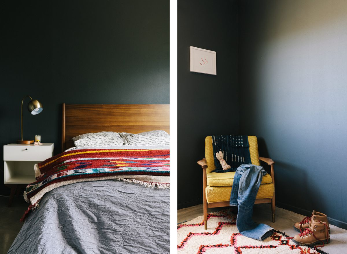 The bedroom is painted a dark-gray color