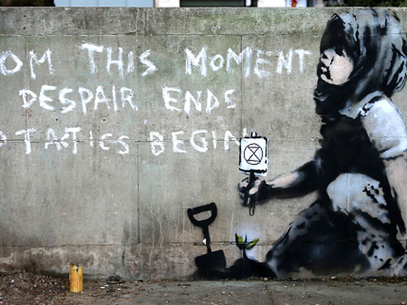 Graffiti artwork, suspected to have been created by the British street artist Banksy, is pictured opposite the environmental protest group Extinction Rebellion's camp at Marble Arch in London on April 26, 2019.