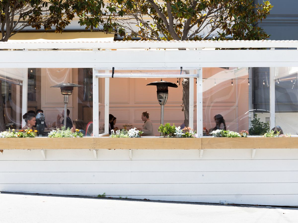 The clean white, wooden parklets at Wildseed