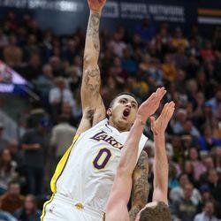 Los Angeles Lakers forward Kyle Kuzma (0) goes to the hoop against Utah Jazz forward Joe Ingles (2) during the game at Vivint Smart Home Arena in Salt Lake City on Tuesday, April 3, 2018.