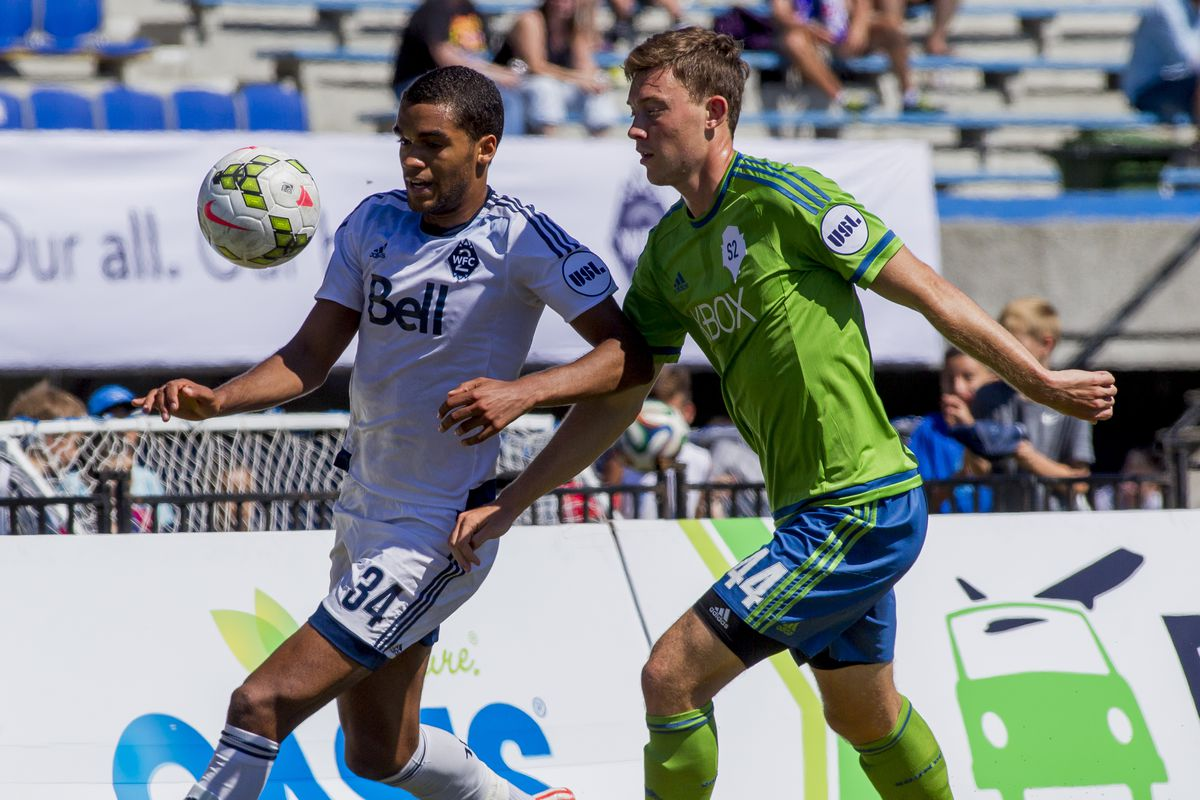 WFC2 stiker Caleb Clarke (L) and Seattle defender Nick Miele battle for the ball during a match between Vancouver and Sounders FC2.  Vancouver won the match by a score of 3-1.