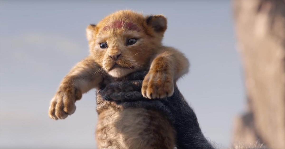 The Lion King (2019) - baby Simba being held up by Rafiki