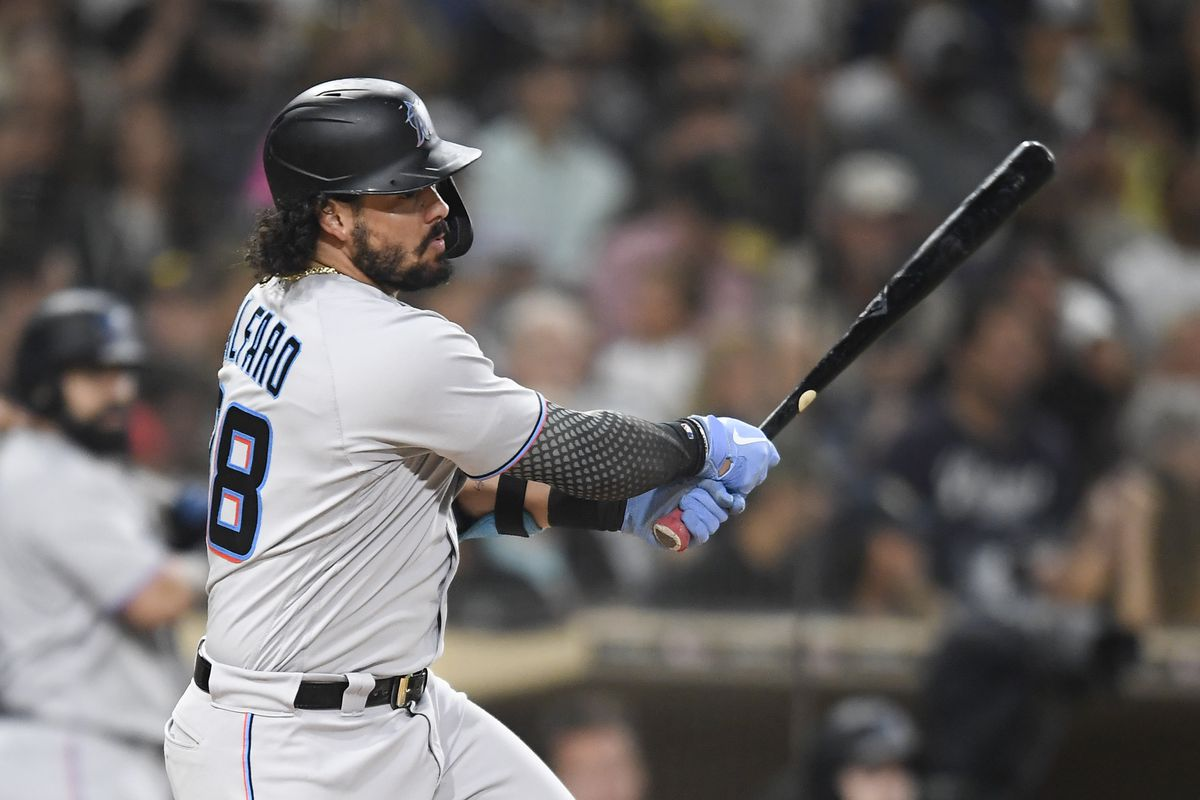 Jorge Alfaro #38 of the Miami Marlins hits a single during the fourth inning of a baseball game against the San Diego Padres at Petco Park
